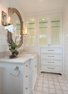 We love the wall of storage in this bathroom, some hidden and some open.