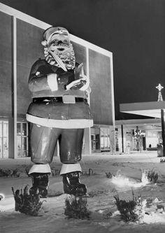 Vintage fiberglass Santa in front of Department store.