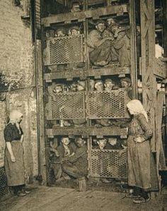 Belgian coal mine elevator, ca 1900.  Photographer: Van Melle, Gent, Belgium. pinned via Antique and Classic Photographic Images.