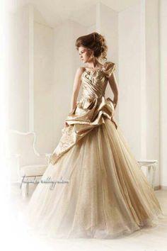 Gold wedding gown Keywords: #goldweddings #goldweddinggowns  #inspirationandideasforgoldweddingplanning #jevel #jevelweddingplanning Follow Us: www.jevelweddingplanning.com www.pinterest.com/jevelwedding/ www.facebook.com/jevelweddingplanning/ https://plus.google.com/u/0/105109573846210973606/ www.twitter.com/jevelwedding/