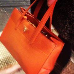 In love with this orange Prada Handbag we spied on the streets of London. #HandbagSpy www.handbag.com