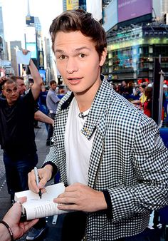 Ansel Elgort signs autographs outside GMA's NYC studios