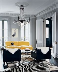 love the chandelier...and the sofa