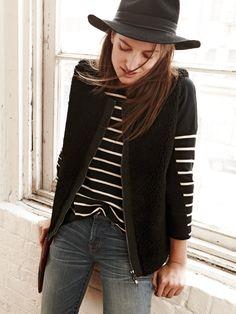 Madewell stripeblock tee worn with faux-fur zip vest + skinny skinny jeans: rip and repair edition.