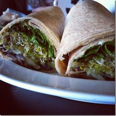 whole wheat wrap w/ red pepper hummus, caramelized onion, goat cheese, sprouts, tomato, spinach and cucumber