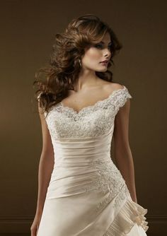 wedding dress...I like the lace but that is really all I like about this