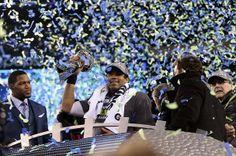 Seahawks QB Russell Wilson hoists Lombardi Trophy after winning Super Bowl XLVIII #SB48