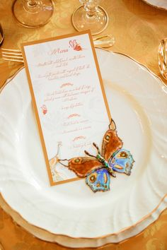 Gold wedding reception menus with butterfly accent via http://www.weddingchicks.com/2014/02/12/let-them-eat-cake-wedding-ideas/