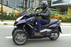three wheel scooter::