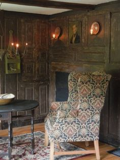 Wonderful early wooden paneled wall ~ Early New England. wing-back chair. candle
