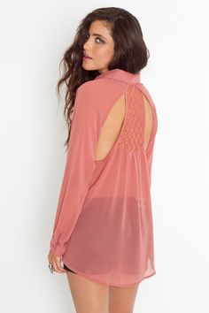 Coral button-down shirt with cutouts in  the back! So cute.