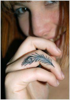tattoo ideas, peacock tattoo, peacock feathers, fingers, finger tattoos, tattoo patterns, feather tattoos, design, white ink