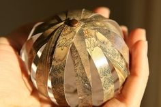 Handcrafted Holiday ~ Paper Ball Ornaments .  Free tutorial with pictures on how to make a bauble in under 40 minutes by papercrafting with scissors, hole punch, and brads. How To posted by Valerie E. Difficulty: 3/5. Cost: Cheap. Steps: 5