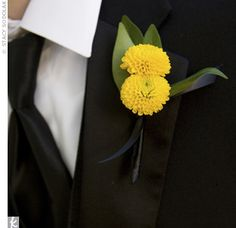 The ushers wore the same tuxes as the groomsmen with matching button mum bouts. The only difference? The guys in the wedding party sported yellow ties—which not only matched the ceremony and reception décor, but also the bride's shoes!