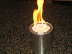 How to make an alcohol stove with cans, toilet paper, rubbing alcohol and a coat hanger (or wire).