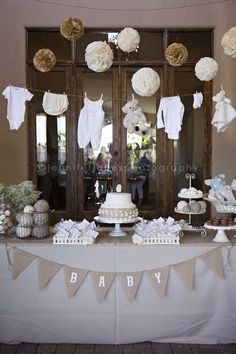 clotheslines, neutral baby shower theme, vintage baby shower theme, babies clothes, shower idea