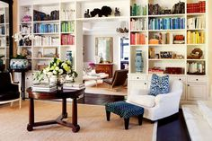 book shelves from floor to ceiling and over entryway.  love how the books are organized by color