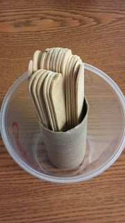 Glue tp roll into bottom and cover with scrapbook paper...used to put group sticks inside and keep separated from student sticks. My Organized Chaotic Classroom: Organization Ideas