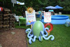 """Backyard Beach Birthday Bash"" floaty and sign"