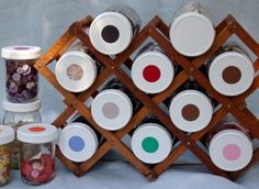 Keep buttons sorted & organized using jars, colored stickers, and a wine rack.