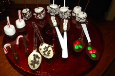 Hot Chocolate Stirrers. Clockwise from top: marshmallow dipped in chocolate with coconut; marshmallow with chocolate and snowflake sprinkles; spoon dipped in chocolate with M&Ms; spoon dipped in chocolate with a marshmallow snowman; spoon dipped in white chocolate with mini chocolate chips; candy cane dipped in chocolate with sprinkles; marshmallow with chocolate and colored sprinkles; and marshmallow with chocolate and crushed peppermints.