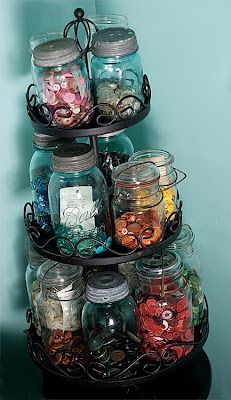 Great tip for the crafty folks! Use a 3-tiered rack to hold mason jars filled with small items, like buttons and pins.  ~ℛ