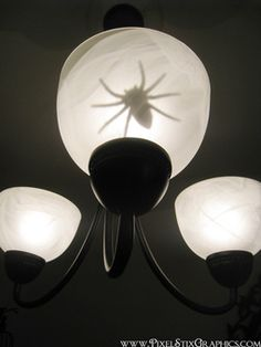 Fake spider inside fixture!  Halloween Decor. Ha, omg I would die
