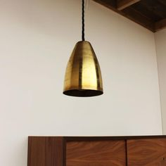 10 Glamorous Pendant Lights for Under $200 – This Brass Shade Lamp: $75