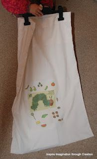 Making a very simple story sack out of a pillow case.  It can be stored in the wardrobe hung up.