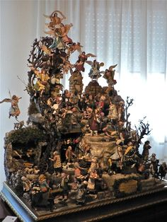 Upstairs in his apartment, where he keeps what he calls his private presepio, 35 figures only, the Holy Family, moors, musicians, courtiers, kings, musicians and angels.