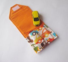 car wallet - haha i like it. This would make the matchbox cars easier to spot when trying to dig them out of the bottom of my purse.