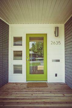 Grey brick white trim green door