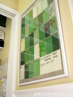 Paint color samples, picture frame, and dry erase marker.  Cute calander idea.
