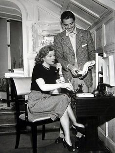 Greer Garson and husband Richard Ney at home.