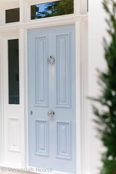 pretty pale blue front door with silver hardware