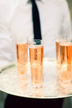 pink champagne  in tall glasses