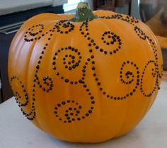 Instead of carving your pumpkin, use thumbtacks to create a one of a kind design!