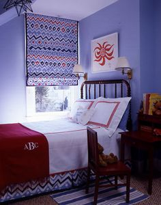 The monogrammed red bed throw adds a nice personal element to the room.