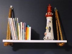 Adore these DIY nautical rope nursery shelves - #nautical #nursery