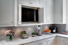 Kitchen TV hidden cabinet by TZS Design - Marcel Page Photography