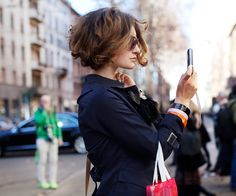 Short Curly Bob. I am going to have to let my hair go natural and try to do this...