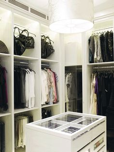 Suzie: Practical Princess - Walk-in closet with silver damask drum pendant, built-in cabinets, ...