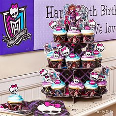 Scare up a tower of Monster High cupcakes that'll make 'em shriek! Start with official Monster High baking cups, skull toppers and cupcake stand. Click for lots more Monster High party ideas!