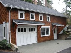 Hinged, Swinging, Swing-Out, or Swing Real Carriage House Garage Doors for your carriage house garage