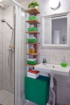 small bathroom storage - narrow tall shelving unit