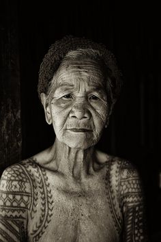 nice! Old lady, woman, female, tattoo, body art, ink, skin, wrinckles, aged, beauty, lines of Life, a face with many stories to tell, powerful eyes, portrait, photo b/w.