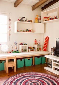 Kids art/play room--i love the low table and storage underneath