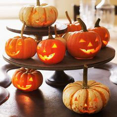 Mini jack-o'-lanterns can make a great Halloween centerpiece! More ideas here: http://www.bhg.com/halloween/indoor-decorating/quick-clever-halloween-centerpieces/?socsrc=bhgpin082014jackolanterncenterpiece&page=9