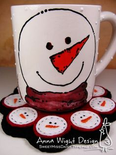 The mug was hand painted at a paint-your-own-pottery shop. Each scallop on the mug rug has a simple snowman face -- two knot eyes, and a quickly stitched carrot for a nose.