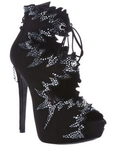 Black suede boots from Philipp Plein featuring an open toe, structured paneling with gem embellishments at the trim, two stud fastenings to the front, a tie-up fastening at the ankle, a zip-up fastening to the back featuring a silver-tone charms, a high stiletto heel heel with a chain logo detail, a concealed platform and a plaque detail on the sole.
